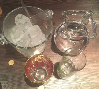 Ice cubes, Water, Empty glass and Efe Green Raki